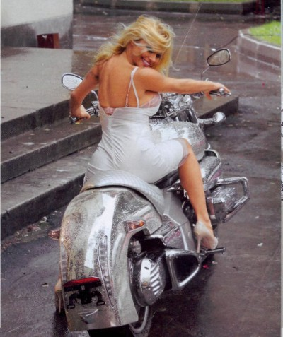 Pamela Anderson Posing on a Cosmichrome bike in Moscow